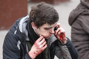 A wounded man outside Park Kultury.